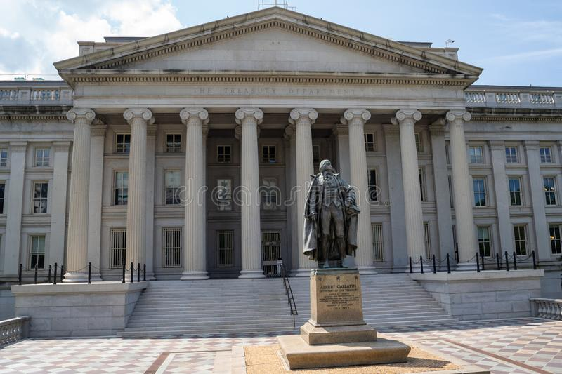 Washington, DC - August 4, 2019: Exterior of the United States Department of Treasury, with statue of Albert Gallatin, secretary. Of the treasury stock photo