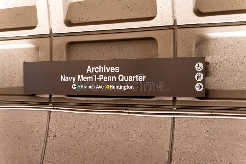 Washington, DC - August 7, 2019: Sign for the Archives Navy Memorial Penn Quarter DC Metro station, underground with green and. Sign for the Archives Navy royalty free stock photo