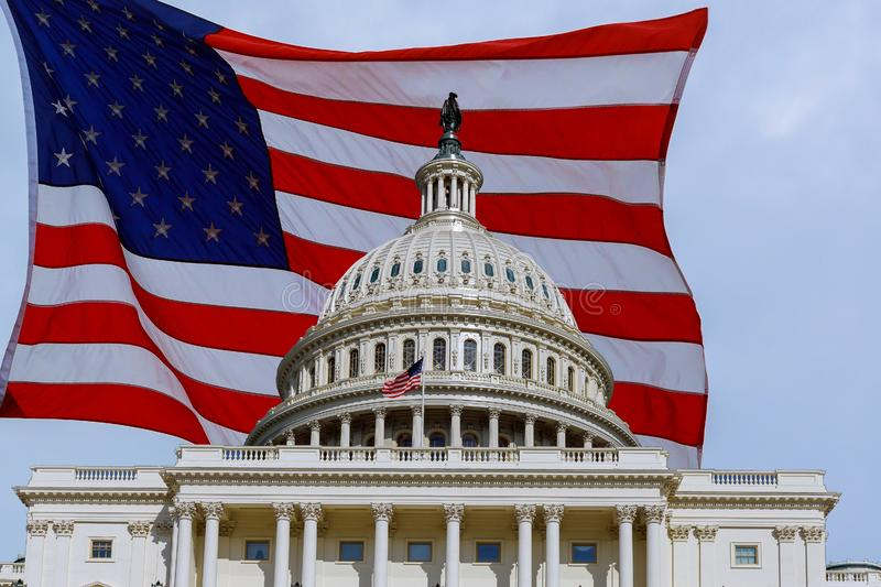 Washington DC Capitol Building on Capitol Hill detail on american flag background royalty free stock photos