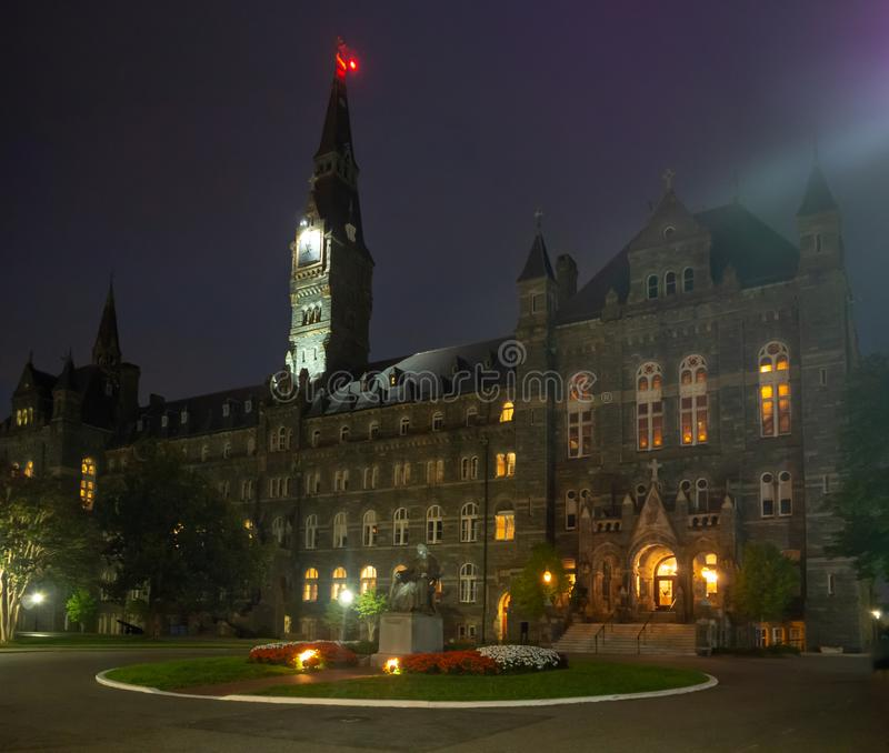 Washington DC, District of Columbia [United States US, Georgetown University at night, chapel and Healy Hall houses classrooms and. Washington DC, District of stock photography