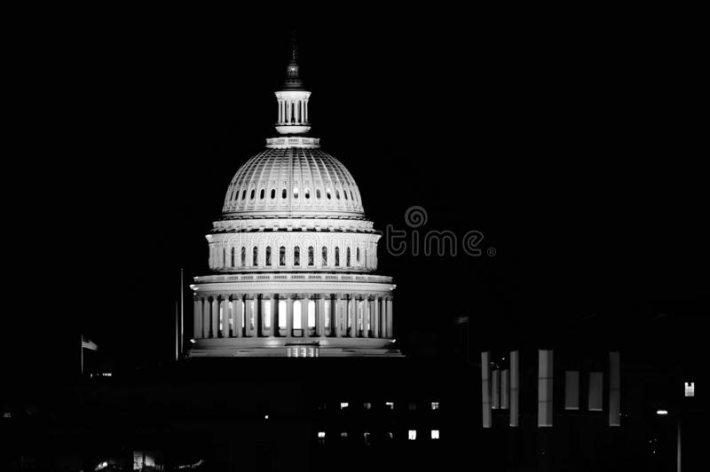 Washington, DC District Columbia / USA - 08 20 2018: US Capitol building at night with two flags flying above. stock photos