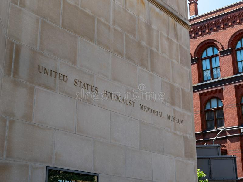 United States Holocaust Memorial Museum entrance sign outside of building. WASHINGTON, DC July 10, 2018: United States Holocaust Memorial Museum entrance sign stock photos