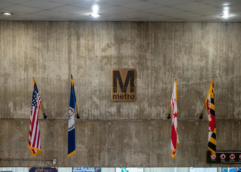 WMATA Metro system logo with US, Virginia, Maryland, DC flags. WASHINGTON, DC July 14, 2018: WMATA Metro system logo with US, Virginia, Maryland DC flags royalty free stock photos