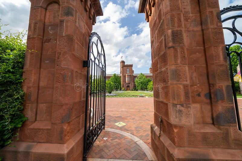 Washington, DC - May 9, 2019: Exterior entrance gate to the Enid Haupt Garden and the Smithsonian Castle on the National Mall.  stock photo