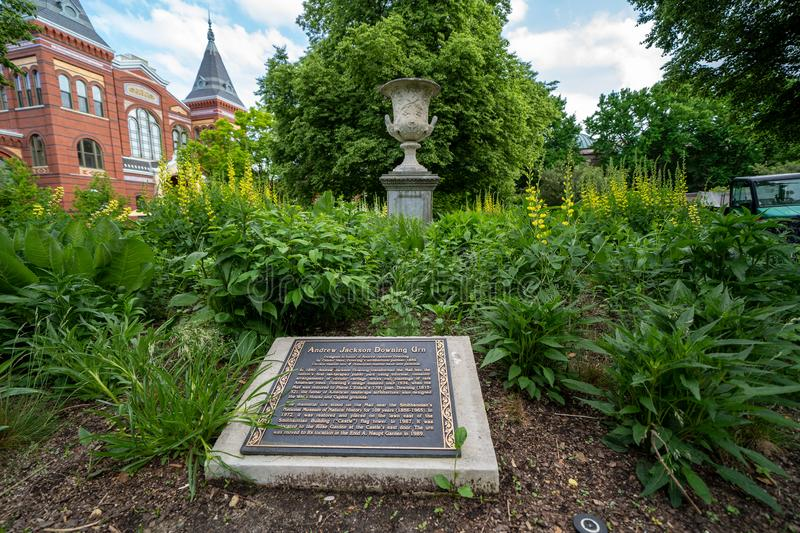 Washington, DC - May 9, 2019: Plaque and urn honoring Andrew Jackson Downing Urn at the Smithsonian Castle Enid Haupt Garden along. The National Mall stock photos