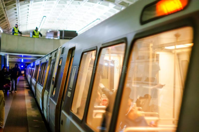 Washington DC Metro. A picture of a Washington DC metro train stopping at the platform at the subway station royalty free stock photography