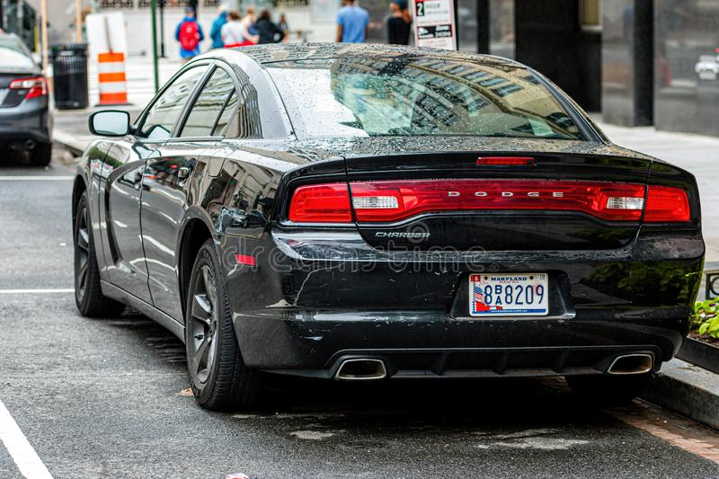 Washington DC, USA - June 9, 2019: luxury American car parked  at the edge of the street. View from back - image. Washington DC, USA - June 9, 2019: luxury royalty free stock photo