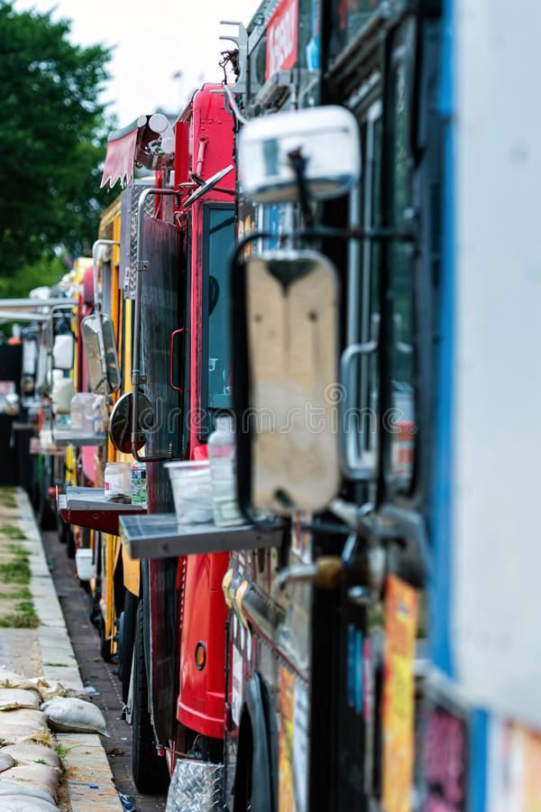 Washington DC, USA - June 9, 2019:  Parked and lined up street food trucks in Washington DC. Selective focus and vintage style royalty free stock images