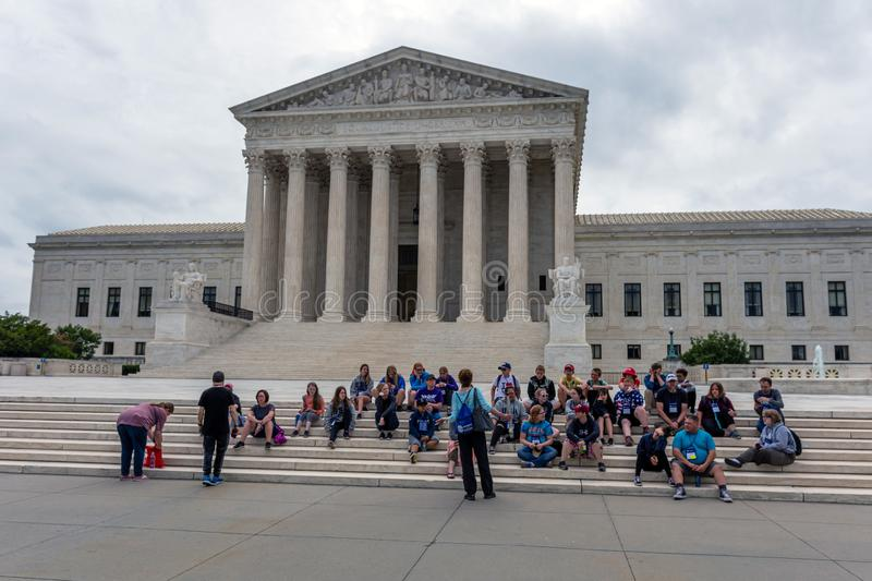 Washington DC, USA - June 9, 2019: Tourists on the  stairs of Supreme Court of the United States of America - image stock photos