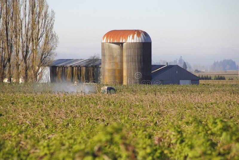 Washington Farmer Fertilizing Crop fotografia de stock royalty free