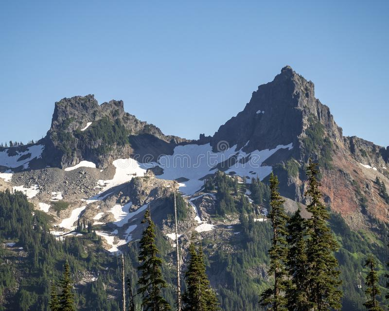 The Castle and Pinnacle Peak in Mt Rainier National Park stock photography