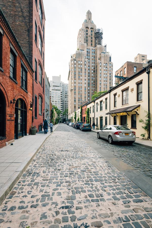 Washington Mews, a cobblestone street in Greenwich Village, Manhattan, New York City royalty free stock image