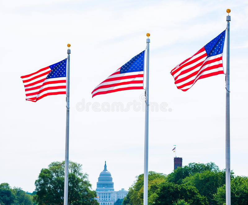 Washington Monument flags and Capitol DC USA stock image