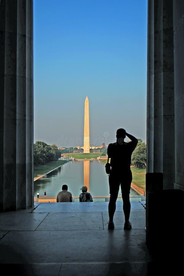 Washington Monument and Photographer. Tourist photographing Washington Monument from the Lincoln Memorial, Washington, DC stock photos