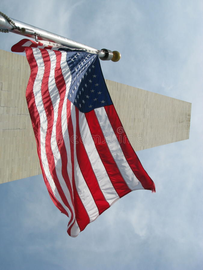 Washington Monument with the USA flag royalty free stock photography