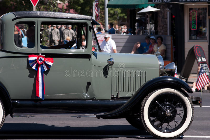 Washington State, USA, August 2011: A vintage car in annual Lentil Festival parade. A driver and his car participating in the annual National Lentil Festival royalty free stock photography