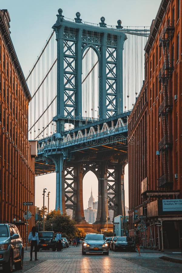 Washington street in Dumbo, Brooklyn with Brooklyn Bridge in Background. New York CIty, USA - July 7, 2018; Washington street in Dumbo, Brooklyn with Brooklyn royalty free stock photo