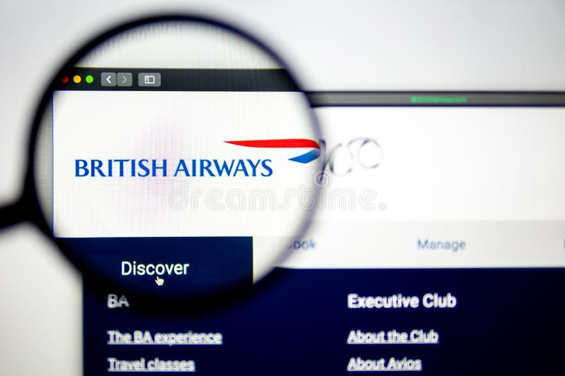 Air carrier British Airways website homepage. British Airways logo visible through a magnifying glass. stock photos