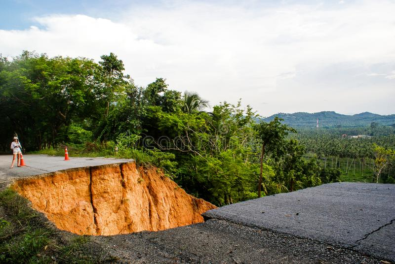 Washout: rain flood damaged badly washed out road in Thailand.  royalty free stock images