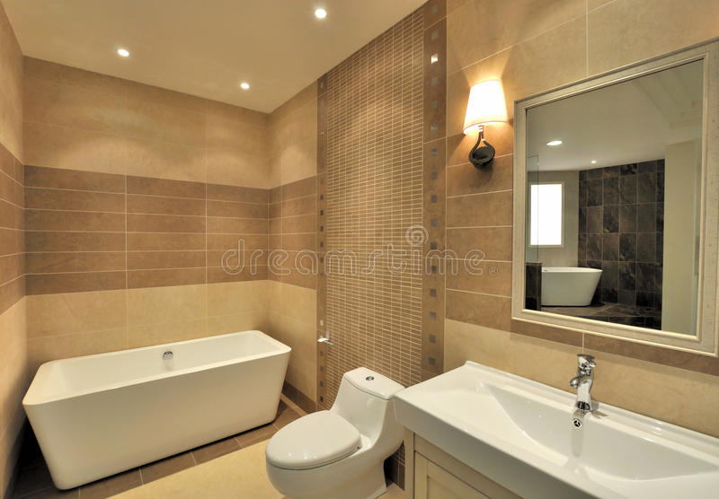 Washroom inside. Washroom with bathtub, closestool, water closet and mirror, shown as functional place and setting in house, and comfortable life style stock photos