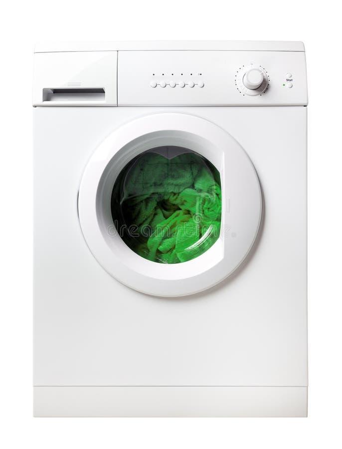 Wasmachine met groene geïsoleerdej wasserij royalty-vrije stock afbeeldingen