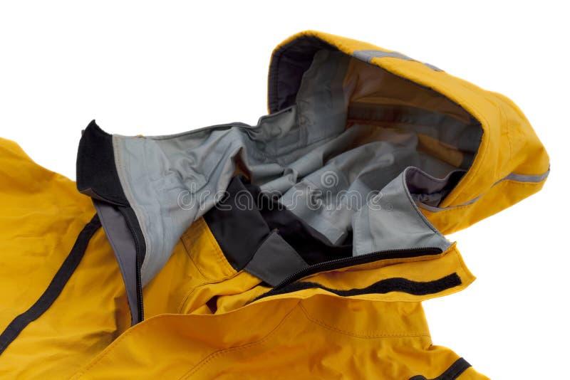 Wasserdichte breathable schaufelnde Jacke mit Haube lizenzfreie stockbilder