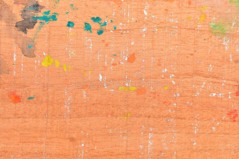 Wasserfarbe auf Holzfußboden, abstrakte Multicolor auf altem Holzboden, abstrakte Malerei auf Holzfußboden lizenzfreie stockfotografie