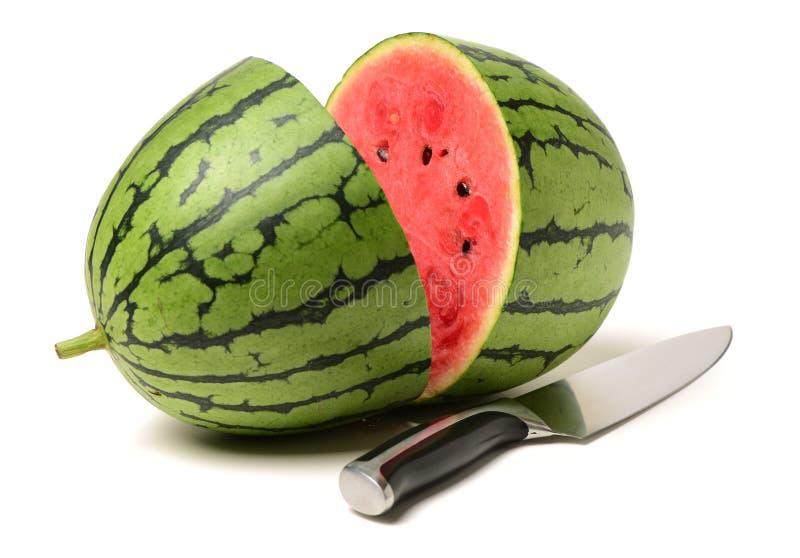 Wassermelone und Messer stockfotos