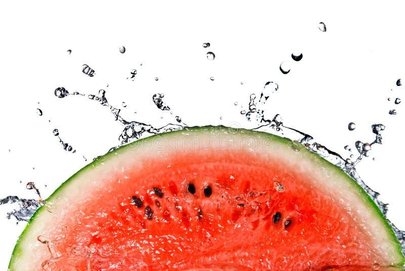 Wassermelone- und Wasserspritzen lizenzfreie stockbilder