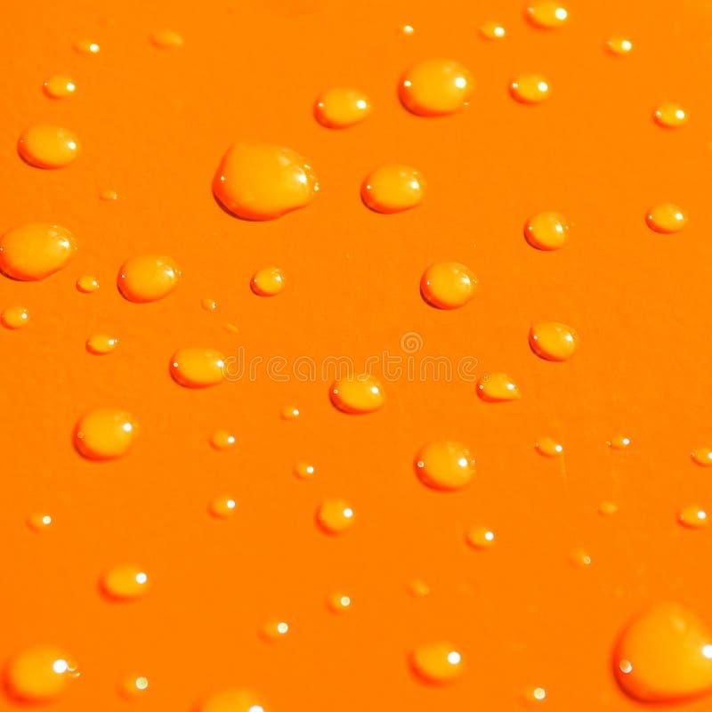 Wassertropfen auf orange Metallba vektor abbildung