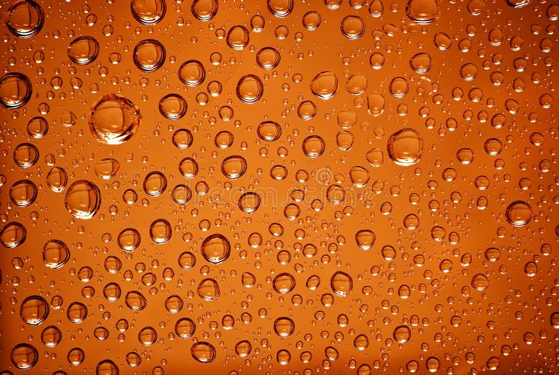 Wassertropfen der Orange stockfotos