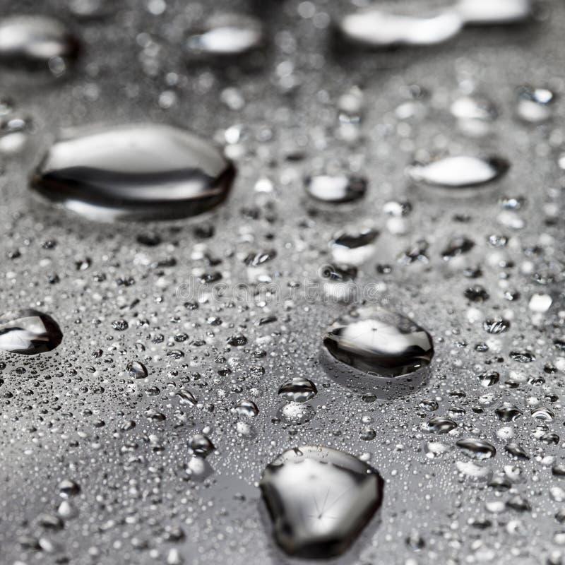 Wassertropfen/flüssiges Metall stockbilder
