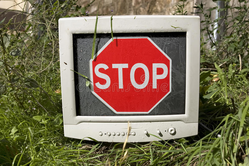 Waste. Abandoned computer monitor seen as Stop Pollution conceptual message stock photos
