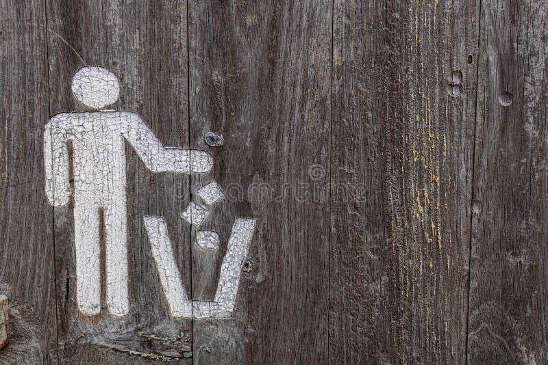Waste bin symbol, on weathered wooden texture. White waste bin symbol, on weathered wooden texture stock photos