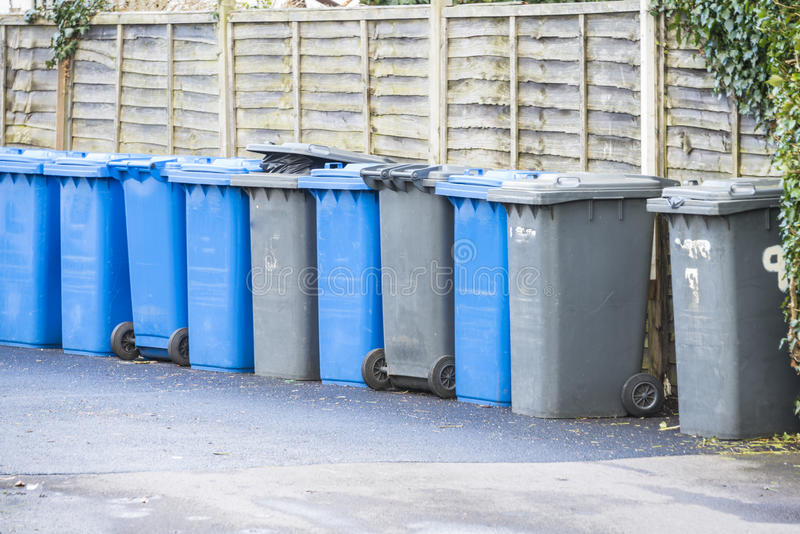 Waste bins. Line up of watse 'wheelie' bins in UK street stock photos