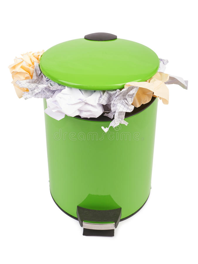 Waste can full up with crumpled paper. Isolated on white backgro royalty free stock photos
