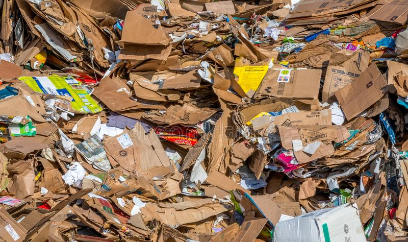 Waste cardboard piled for recycling. Victoria British Columbia, Canada- 04/30/2019 : Waste cardboard is piled up awaiting shipping and processing at a recycling stock photography