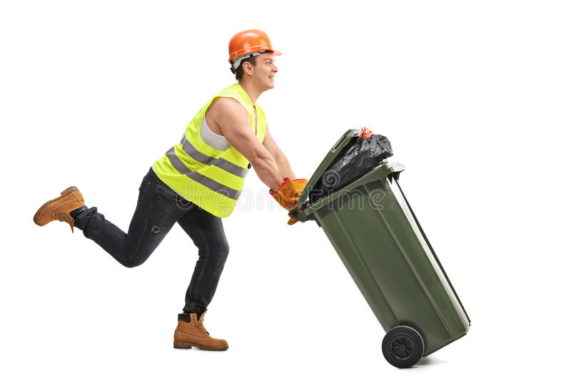 Waste collector pushing a trash can. Excited young waste collector pushing a trash can and running isolated on white background stock image