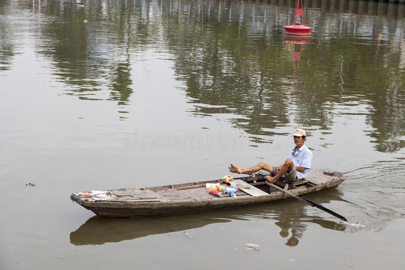 Waste collector on Saigon river. Saigon river in Ho Chi Minh city is extremely polluted. Both from industrial and human waste. In Ho Chi Minh city there are poor royalty free stock photos