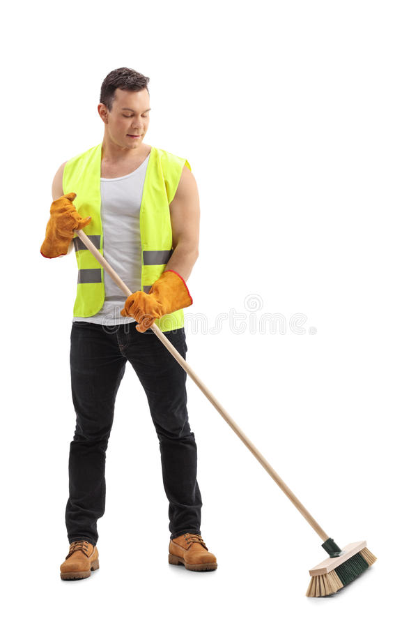 Waste collector sweeping with a broom. Full length portrait of a waste collector sweeping with a broom isolated on white background stock image