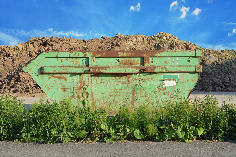 Waste container. Green waste container with blue sky royalty free stock photo