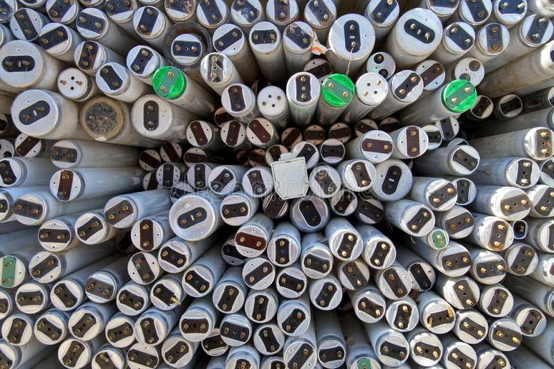 Large amount of spent old fluorescent lamp tubes about to be recycled. royalty free stock photo