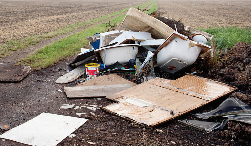 Waste dumping. Household building waste that has been dumped on agricultural land. Environmental polution stock photos