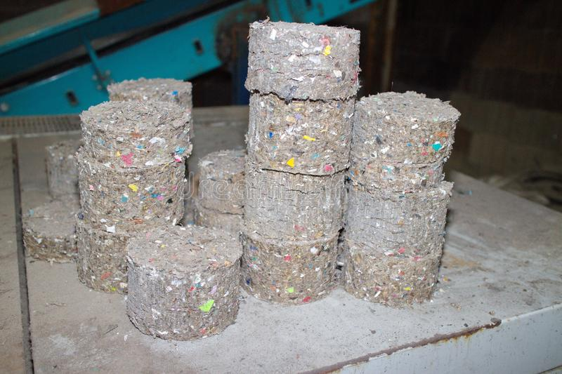 Waste fuel briquettes. Recycling, fuel briquettes, waste, material garbage royalty free stock photography