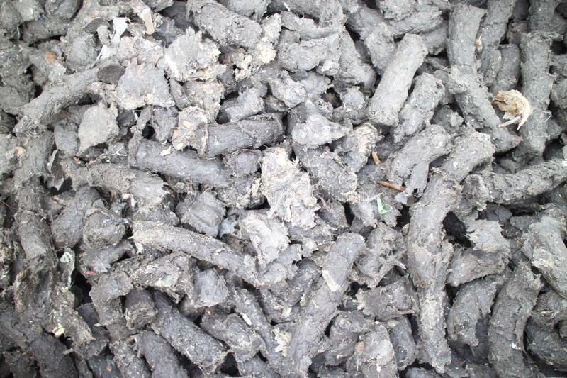 Waste fuel briquettes. Recycling, fuel briquettes, waste, material garbage stock photography