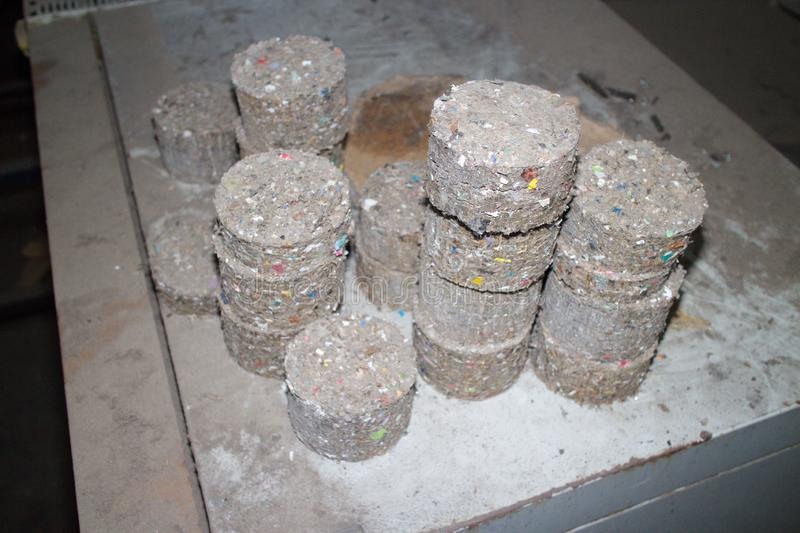 Waste fuel briquettes. Recycling, fuel briquettes, waste, material garbage stock image