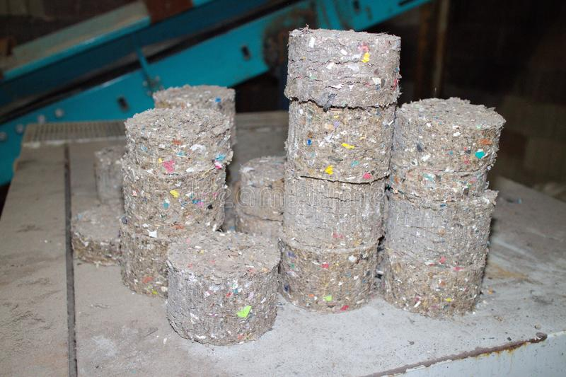 Waste fuel briquettes. Recycling, fuel briquettes, waste, material garbage royalty free stock images