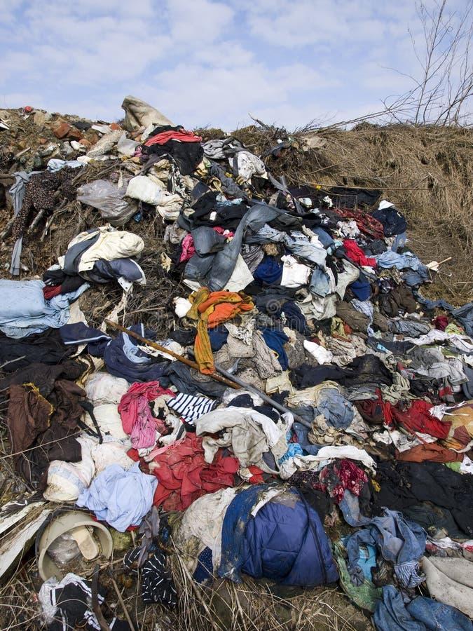 Waste heap on junkyard. Communal waste on the junkyard royalty free stock photography