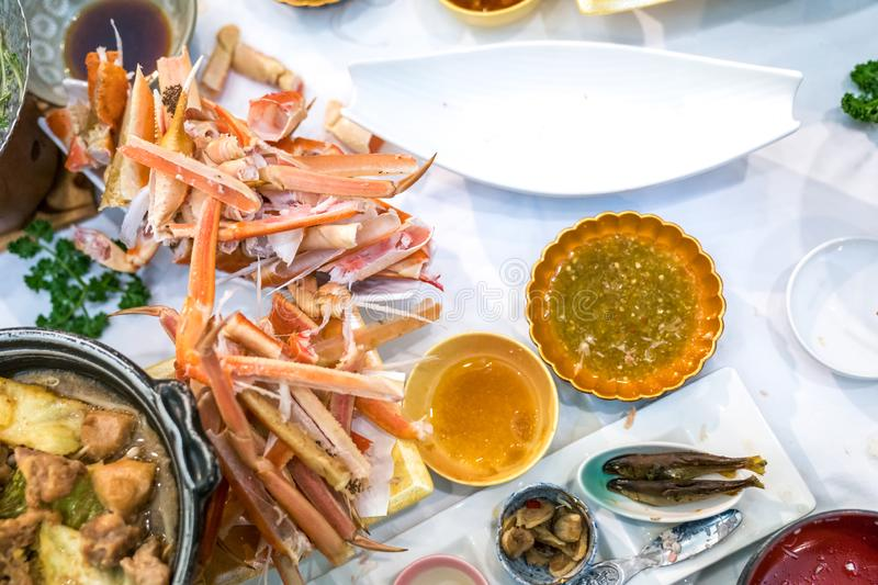 Waste Japanese claw and leg steamed crab on white dish. Look like a graveyard of Crab royalty free stock images