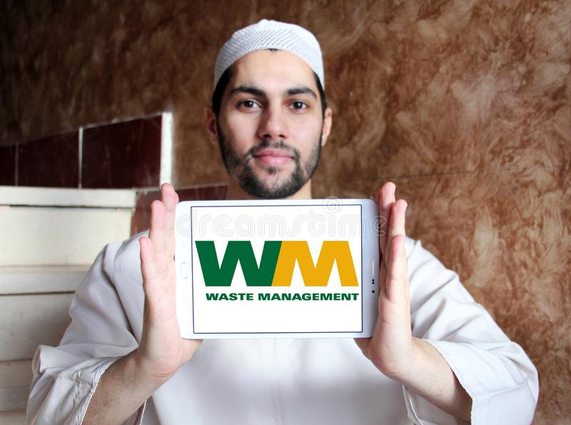 Waste Management company logo. Logo of Waste Management company on samsung tablet holded by arab muslim man. Waste Management, Inc. is an American waste royalty free stock photo